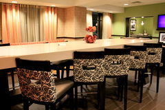Inviting scene of long tables and chairs in ultra-modern design in dining area, Holiday Inn, Waterloo, New York,2015 Royalty Free Stock Image