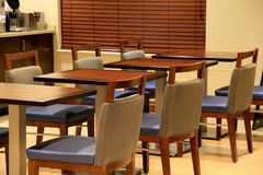 Inviting scene with tables and chairs in breakfast nook Royalty Free Stock Image