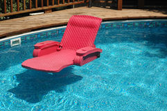 Inviting swimming pool. Floating water chaise lounge Royalty Free Stock Photography