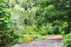 Inviting Walkway. An inviting walkway in a manicured park royalty free stock photography