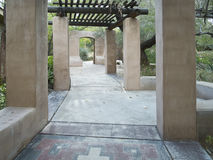 Inviting walkway through a desert garden Stock Photo