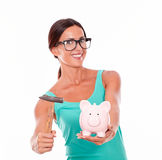Inviting woman with pink piggy bank Royalty Free Stock Image