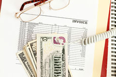 Invoice. An invoice sheet showing big unpaid balance with telephone cord Royalty Free Stock Photography