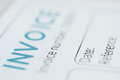 Invoice. Close-up picture of an invoice, light blue tint