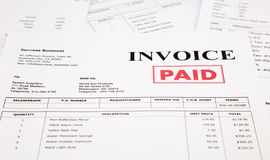 Invoice and bills with paid stamp Stock Photo