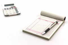 Invoice book which open blank page with pen and calculator. Stock Images