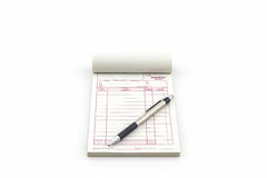 Invoice book which open blank page with pen. Stock Photos