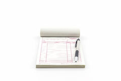 Invoice book which open blank page with pen. Stock Photography