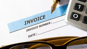 Invoice business document inform to deptor for payment. On white paper royalty free stock image