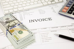 Invoice documents  and dollar money banknotes on office table Stock Image