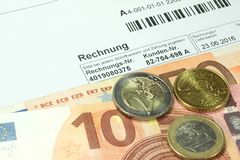 An invoice and euro bills. One bill and many euro banknotes royalty free stock photos