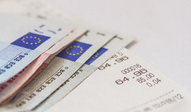 Invoice. Paid invoice with euro banknotes Royalty Free Stock Image