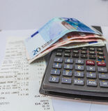 Invoice. Paid invoice with euro banknotes Stock Photos