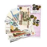 Invoice for payment with banknotes and coins Stock Image