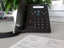 Invoice and phone Stock Photo