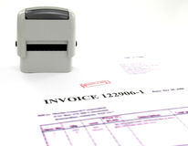 "Invoice posted. Represent paper copy of computer invoice mark up for document turn ""POSTED"" and the stamps used for stamping of invoices Stock Image"