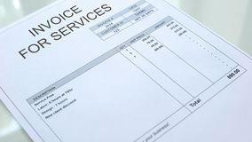Invoice for services commercial document lying on table, business, template. Stock photo stock illustration