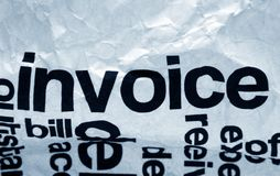 Invoice text on crinkled paper. Close up of Invoice text on crinkled paper Royalty Free Stock Image