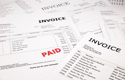 Invoices and bills with paid stamp. Difference invoices and bills with red paid stamp, concept and ideas Royalty Free Stock Photo