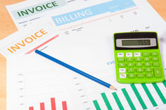 Invoices with calculator Stock Photos
