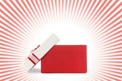 Involucro di bianco e rosso del presente dal nastro Fotografie Stock