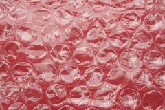 Involucro di bolla su colore rosso Immagine Stock Libera da Diritti