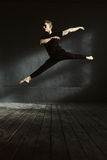 Involved ballet dancer stretching in the air Royalty Free Stock Photos