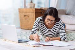 Involved charming woman working on the project at home Stock Images