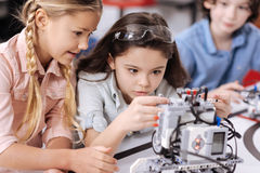 Involved children discussing project at school Royalty Free Stock Photography