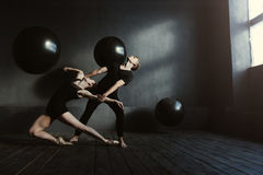 Involved proficient gymnasts performing in interaction with each other Stock Image