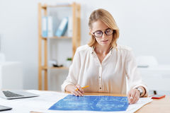 Involved woman working on the engineering project in the office Royalty Free Stock Photo