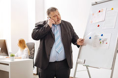 Involved worker discussing something with his colleague Royalty Free Stock Image