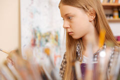 Involved young girl practicing painting in the art school Royalty Free Stock Image
