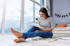 Involved young woman drawing at home Stock Photo