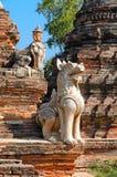 Inwa (Ava). Myanmar. Stone lions guarding the entrance. Inwa (Ava). Myanmar Royalty Free Stock Photo