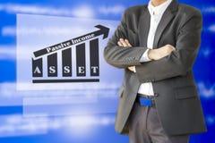 Inwestor wskazuje wartości dna obwódki wydatkowym botto Fotografia Stock