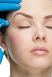 Inyección cosmética del botox Imagenes de archivo