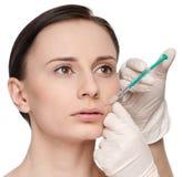Inyección cosmética del botox en la cara de la belleza Fotografía de archivo libre de regalías