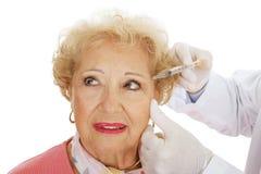 Inyección cosmética - ojos Fotos de archivo libres de regalías