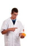 Inyección en las frutas. Fruta genético modificada Imágenes de archivo libres de regalías