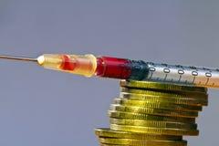 Inyección y dinero Foto de archivo
