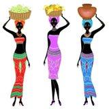 inzameling Mooie Afro-Amerikaanse dame Het meisje draagt een mand op haar hoofd met dadelpruimen, sinaasappelen, bananen, druiven royalty-vrije illustratie
