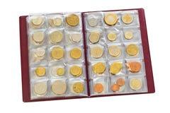 Inzameling van de muntstukken van het wereldgeld in album Stock Afbeeldingen