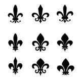 Inzameling van fleur DE lis symbolen - zwarte silhouetten Stock Foto