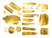 Inzameling van gouden verfslagen om een achtergrond te maken stock afbeelding