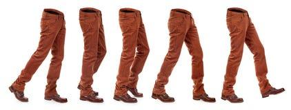 Inzameling van lege jeans in motie met schoenen Stock Afbeelding