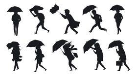 Inzameling van mensen die onder de wind van het regenonweer met paraplu's lopen stock illustratie