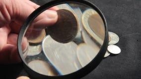 Inzameling van muntstukken stock footage