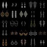 Inzameling van oorringen op zwarte achtergrond royalty-vrije stock foto