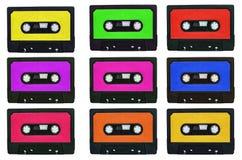 Inzameling van retro cassetebanden met multicolored stickers ISO Royalty-vrije Stock Afbeeldingen